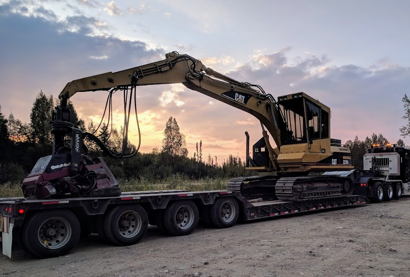 Cat320BL loaded on Coutlee Services lowboy